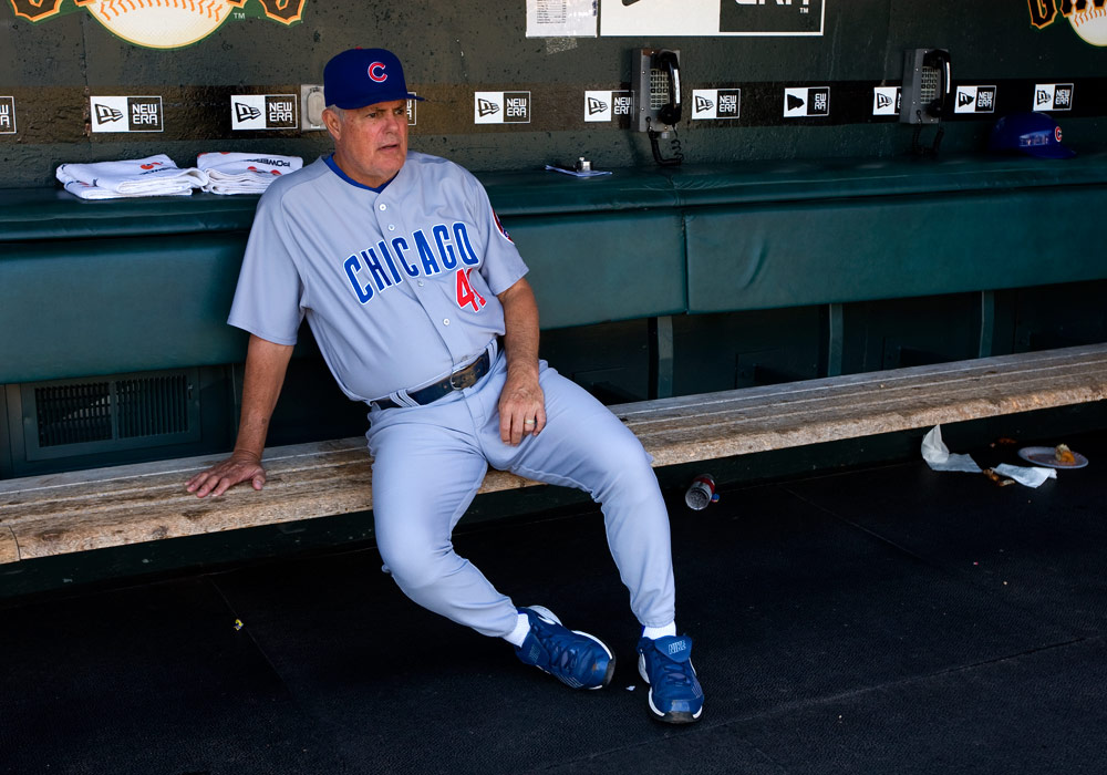 Manager Lou Piniella #41 of the Chicago Cubs gets ready in the dugout before the game against the San Francisco Giants at AT&T Park on September 26, 2009 in San Francisco, California.