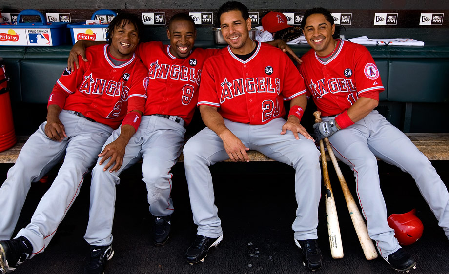 From left: Erick Aybar, Chone Figgins, Juan Rivera, and Maicer Izturis of the Los Angeles Angels of Anaheim get ready in the dugout before the game against the San Francisco Giants at AT&T Park in San Francisco, California on Wednesday, June 17, 2009.