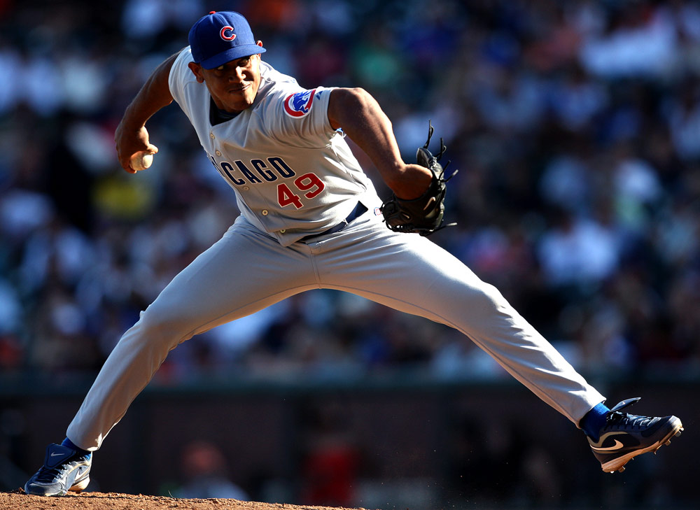 Backlight is beautiful! Carlos Marmol #49 of the Chicago Cubs pitches against the San Francisco Giants during the game at AT&T Park on September 26, 2009 in San Francisco, California. (Photo by Brad Mangin)