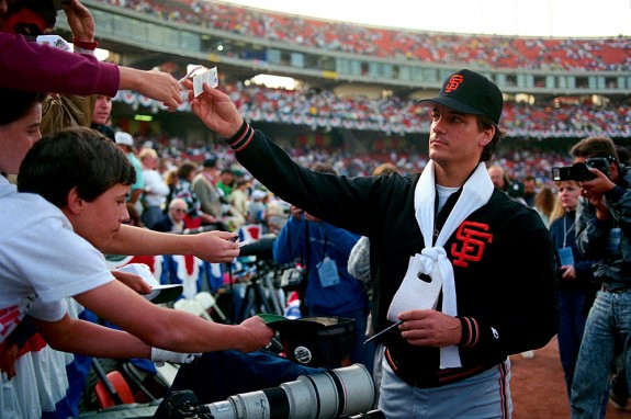 Dave Dravecky of the San Francisco Giants signs autographs before Game 2 of the 1989 World Series against the Oakland Athletics at the Oakland Coliseum in Oakland, California in 1989. (Photo by Brad Mangin)