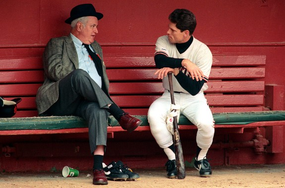 Brett Butler of the San Francisco Giants talks to San Francisco Examiner sports writer Harry Jupiter in the dugout before a game at Candlestick Park in San Francisco, California in 1989. (Photo by Brad Mangin)