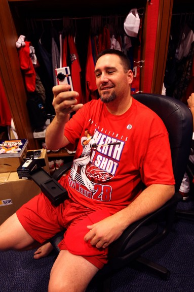 Philadephia Phillies pitcher Scott Eyre shoots video of me taking his picture in the Phillies clubhouse prior to Game 3 of the World Series at Citizens Bank Park in Philadelphia. The Flip video camera was a gift from the MLB Network. (Photo by Brad Mangin/MLB Photos)