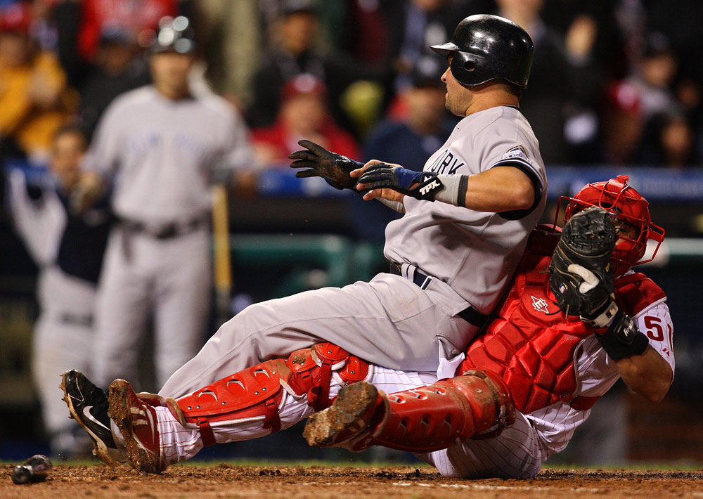 Yankees base runner Nick Swisher is safe at home plate as Phillies catcher Carlos Ruiz applies a late tag in Game 3 of the World Series. (Photo by Brad Mangin/MLB Photos)