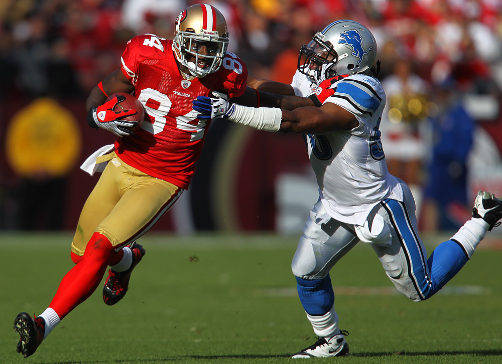 Josh Morgan #84 of the San Francisco 49ers runs with the football during the game against the Detroit Lions at Candlestick Park in San Francisco, California on Sunday, December 27, 2009. (Photo by Brad Mangin)