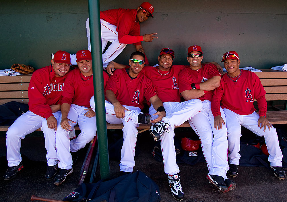 Kendry Morales, Juan Rivera, Bobby Abreu, Maicer Izturis, Erick Aybar and other teammates of the Los Angeles Angels of Anaheim hangs gather for a picture in the dugout before a spring training game against the Cincinnati Reds on March 10, 2010 at Tempe Diablo Stadium in Tempe, Arizona. (Photo by Brad Mangin)
