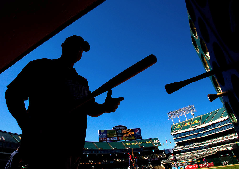 Jim Thome #25 of the Minnesota Twins puts a bat in the bat rack in the Twins dugout before the game against the Oakland Athletics at the Oakland-Alameda County Coliseum on June 5, 2010 in Oakland, California. (Photo by Brad Mangin)