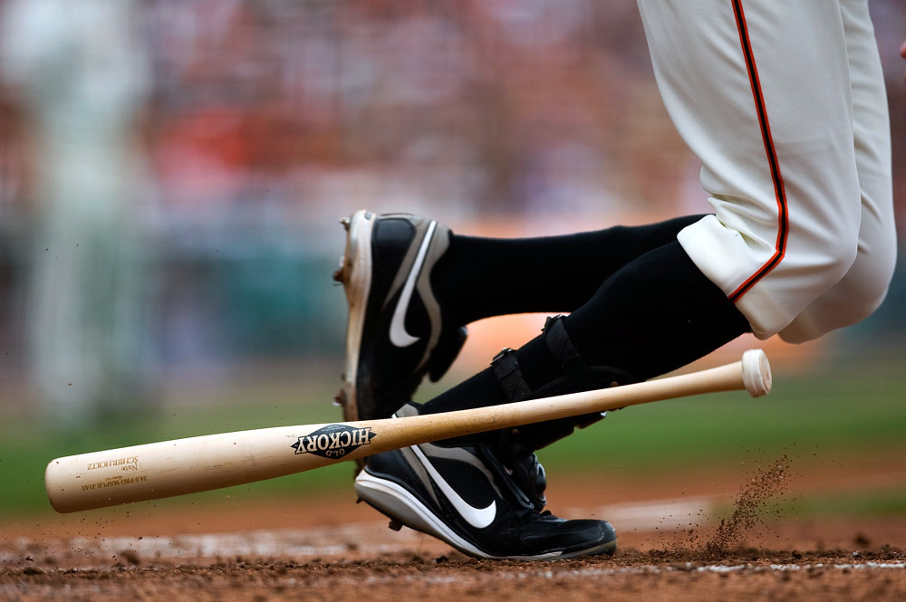 "This picture is featured in the film ""The Tenth Inning."" Nate Schierholtz of the San Francisco Giants bats against the Los Angeles Dodgers during the game at AT&T Park on September 13, 2009 in San Francisco, California. (Photo by Brad Mangin)"