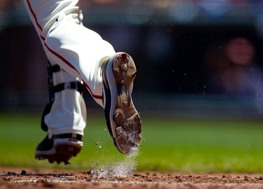 Nate Schierholtz #12 of the San Francisco Giants leaves the batters box kicking up dirt and chalk during the game between the Arizona Diamondbacks and the San Francisco Giants on Thursday, May 12, 2011 at AT&T Park in San Francisco, California. (Photo by Brad Mangin)