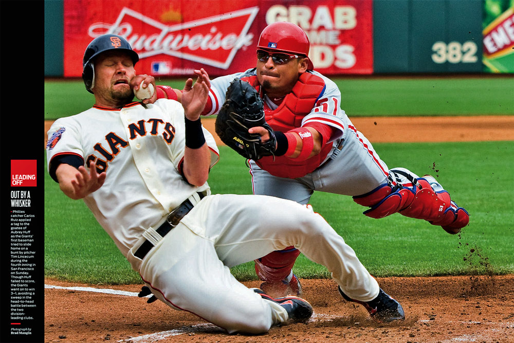 "This picture of Giants base runner Aubrey Huff being tagged out at home plate by Phillies catcher Carlos Ruiz was published as a ""Leading Off"" two-page spread in this week's issue of Sports Illustrated. (Photo by Brad Mangin)"