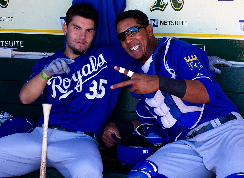 Eric Hosmer #35 and Salvador Perez #13 of the Kansas City Royals get ready in the dugout before the game against the Oakland Athletics at O.co Coliseum on September 5, 2011 in Oakland, California. (Photo by Brad Mangin)