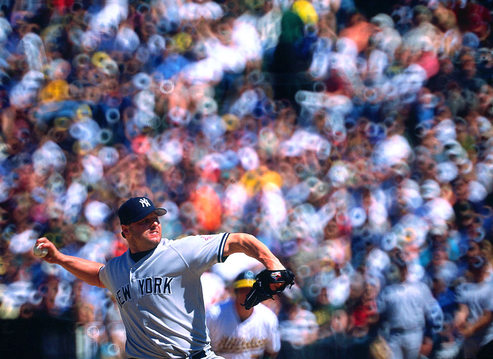 SHOT WITH A NIKON F4 AND A NIKON 500mm 5.6 MIRROR LENS ON FUJICHROME 100: Roger Clemens of the New York Yankees pitches during a game against the Oakland Athletics at the Oakland Coliseum in Oakland, California on May 10, 2003. (Photo by Brad Mangin)