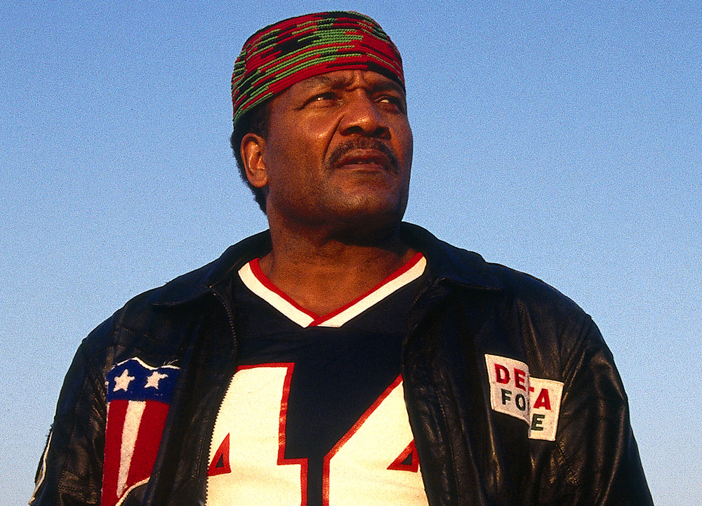 "Former Cleveland Browns great Jim Brown poses for a portrait outdoors in ""the Jungle"" in Los Angeles, California in 1991. (Photo by Brad Mangin)"