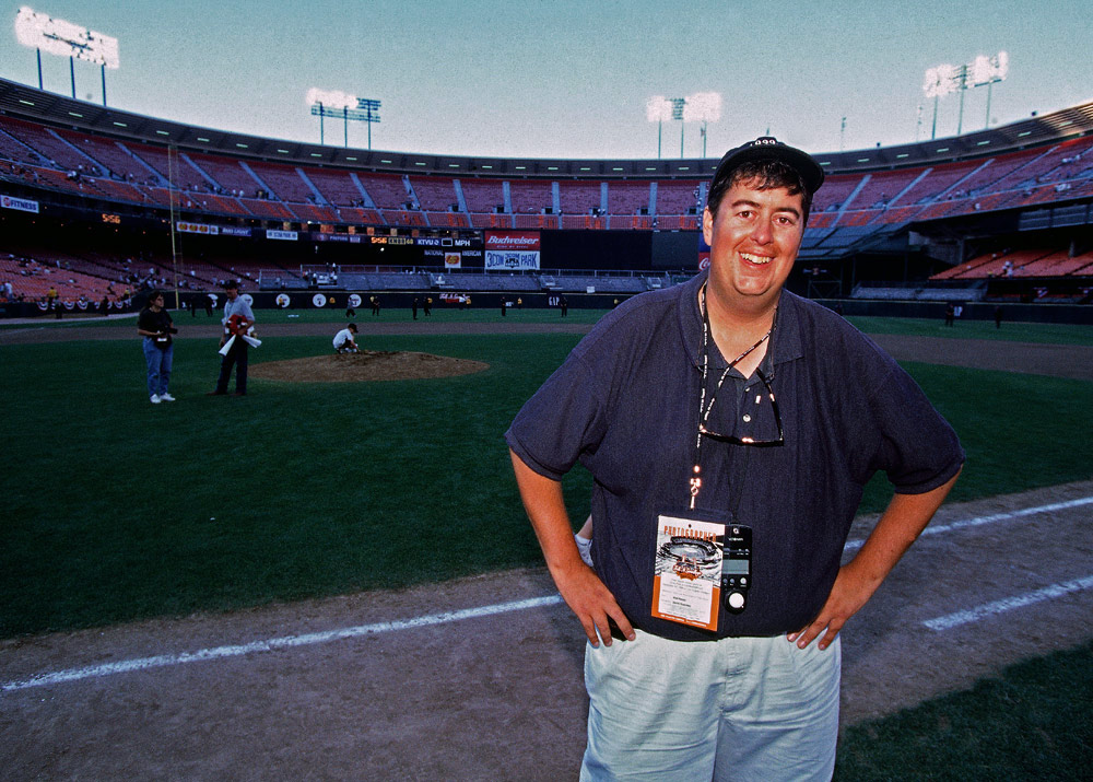 Photographer Brad Mangin poses on the field after the San Francisco Giants last game at against the Los Angeles Dodgers at Candlestick Park in San Francisco, California on September 30, 1999. (Photo by Martha Jane Stanton)