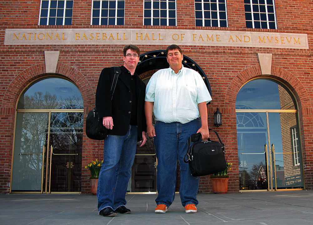 pose in front of the national baseball hall of fame and museum in cooperstown new york before lecturing about baseball photography on april 17 2009