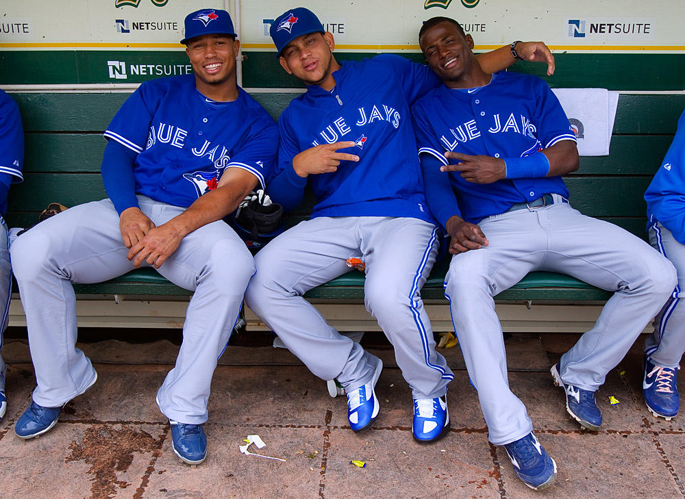 Moises Sierra #15, Henderson Alvarez #37, and Adeiny Hechavarria #3 of the Toronto Blue Jays get ready in the dugout before the game against the Oakland Athletics on Sunday, August 5, 2012 at The Coliseum in Oakland, California. (Photo by Brad Mangin/MLB Photos)