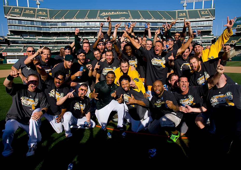 Members of the Oakland Athletics celebrate on the pitchers mound after the game against the Texas Rangers on Wednesday, October 3, 2012 at The Coliseum in Oakland, California. (Photo by Brad Mangin/MLB Photos)