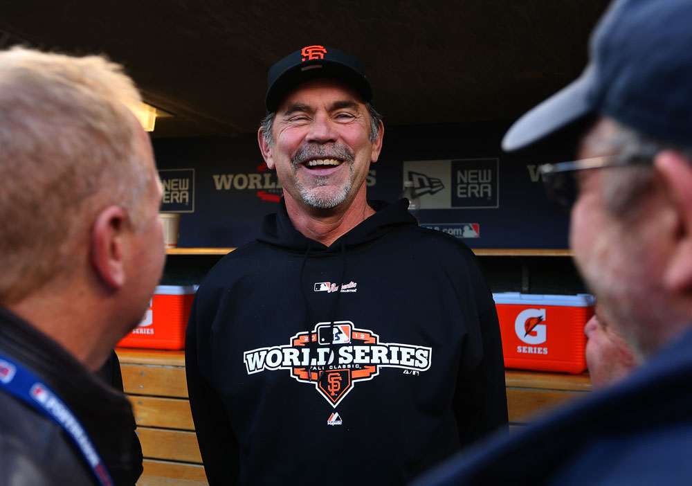 Manager Bruce Bochy of the San Francisco Giants jokes with reporters in the dugout before playing the Detroit Tigers in Game 3 of the 2012 World Series on Saturday, October 27, 2012 at Comerica Park in Detroit, Michigan. (Photo by Brad Mangin/MLB Photos)