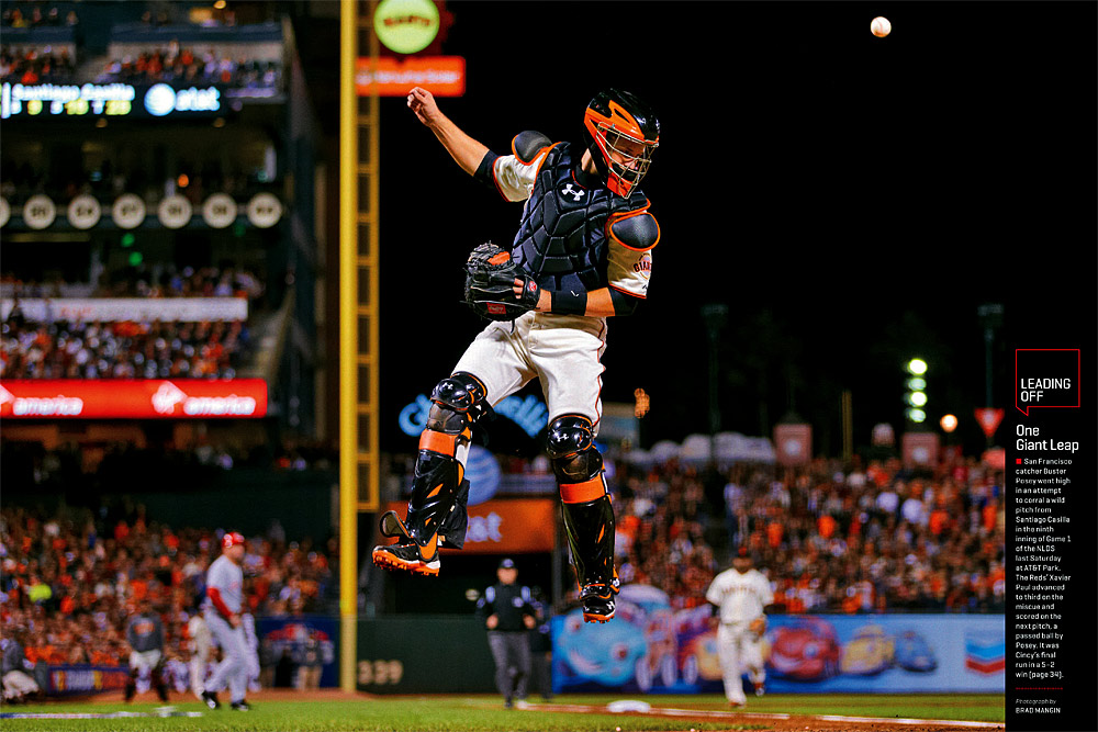 Buster Posey #28 of the San Francisco Giants leaps high in the hair to try and catch a wild pitch that bounced off the backstop against the Cincinnati Reds during NLDS Game 1 at AT&T Park on October 6, 2012 in San Francisco, California. (Photo by Brad Mangin)