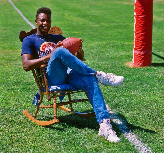 Jerry Rice of the San Francisco 49ers poses in a rocking chair during training camp at Sierra College in Rocklin, California in 1988. (Photo by Brad Mangin)
