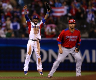 Jose Reyes of the Dominican Republic celebrates after beating Puerto Rico to win the World Baseball Classic championship against Puerto Rico at AT&T Park in San Francisco on march 19, 2013. (Photo by Brad Mangin)