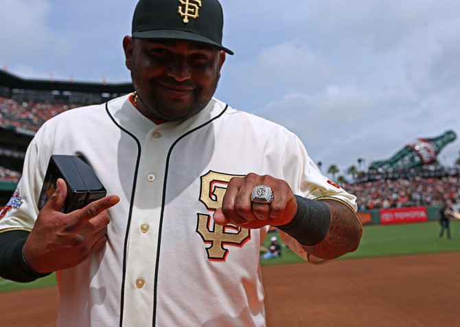 Pablo Sandoval #48 of the San Francisco Giants shows off his 2012 Championship Ring during a pregame ceremony honoring the 2012 World Series champions before their game against the St. Louis Cardinals at AT&T Park on April 7, 2013 in San Francisco, California.(Photo by Brad Mangin/MLB Photos)