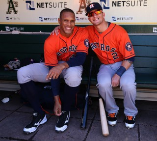Justin Maxwell #44 and Brandon Barnes #2 of the Houston Astros get ready in the dugout before the game against the Oakland Athletics on Wednesday, April 17, 2013 at The O.co Coliseum in Oakland, California. (Photo by Brad Mangin/MLB Photos)