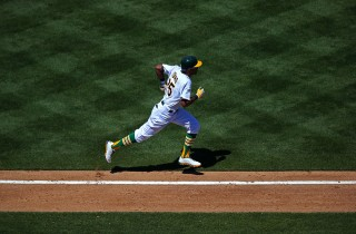 Chris Young #25 of the Oakland Athletics runs to first base against the Texas Rangers during the game at O.co Coliseum on Sunday, August 4, 2013 in Oakland, California. (Photo by Brad Mangin)