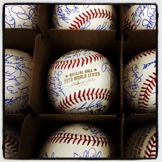 Instagram of Boston Red Sox autographed team baseballs in the Red Sox clubhouse before Game 2 of the 2013 World Series between the Boston Red Sox and the St. Louis Cardinals at Fenway Park on Thursday, October 24, 2013 in Boston, Massachusetts. (Photo by Brad Mangin/MLB Photos)