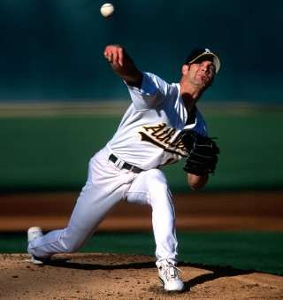Tim Hudson of the Oakland Athletics pitches during a game at the Oakland Coliseum in Oakland, California in 2002. (Photo by Brad Mangin)