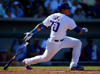 Javier Baez of the Chicago Cubs bats during a spring training game against the Cleveland Indians at Cubs Park in Mesa, Arizona on March 7, 2014. Photo by Brad Mangin