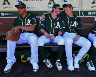 Kyle Blanks #88, Eric Sogard #28, and Sonny Gray #54 of the Oakland Athletics hang out in the dugout before the game against the Boston Red Sox at O.co Coliseum on Sunday, June 22, 2014 in Oakland, California. (Photo by Brad Mangin)