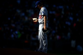 Clayton Kershaw #22 of the Los Angeles Dodgers puts resin on his hand during the game against the San Francisco Giants at AT&T Park on Saturday, July 26, 2014 in San Francisco, California. (Photo by Brad Mangin)