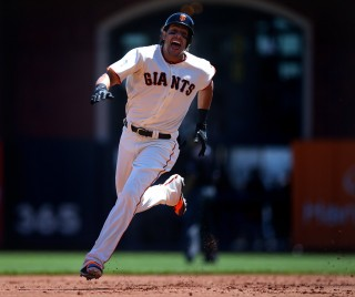 Michael Morse #38 of the San Francisco Giants runs the bases to leg out a triple against the Philadelphia Phillies during the game at AT&T Park on Saturday, August 16, 2014 in San Francisco, California. (Photo by Brad Mangin)