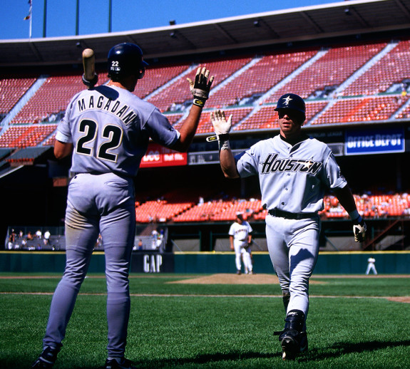 SAN FRANCISCO, CA - Jeff Bagwell of the Houston Astros in action getting congratulated on his way back to the dugout by teammate Dave Magadan during a game against the San Francisco Giants at Candlestick Park in San Francisco, California in 1995. Photo by Brad Mangin