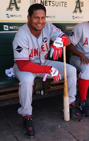 Bobby Abreu #53 of the Los Angeles Angels of Anaheim gets ready in the dugout before the game against the Oakland Athletics at the Oakland-Alameda County Coliseum on July 19, 2009 in Oakland, California.