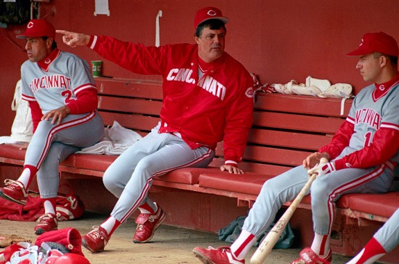 Manager Lou Piniella of the Cincinnati Reds sits in the dugout and talks to Chris Sabo before a game against the San Francisco Giants at Candlestick Park in San Francisco, California in 1990.