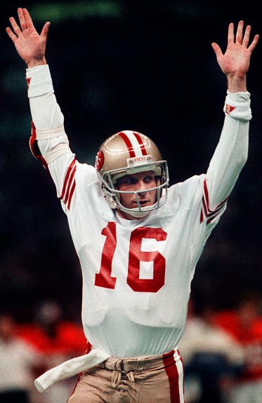 Quarterback Joe Montana of the San Francisco 49ers signals for a touchdown during Super Bowl XXIV against the Denver Broncos at the Superdome in New Orleans, Louisiana in January of 1990. Photo by Brad Mangin